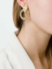 https://www.farfetch.com/uk/shopping/women/givenchy-vintage-pendant-loop-earrings-item-11453905.aspx?storeid=9246&from=listing&ffref=lp_pic_11_1_