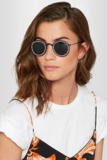 https://www.net-a-porter.com/gb/en/product/958482/freda_banana/vic-embellished-round-frame-metal-and-faux-leather-sunglasses