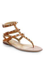 https://www.matchesfashion.com/products/Valentino-Rockstud-flat-leather-sandals-1180433
