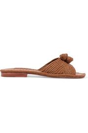 https://www.net-a-porter.com/gb/en/product/1046470/Carrie_Forbes/salma-pompom-embellished-woven-faux-raffia-slides