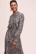 https://www.anthropologie.com/en-gb/shop/mora-ruffled-printed-midi-dress?category=dress-shop&color=001