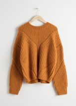 https://www.stories.com/en_gbp/clothing/knitwear/product.oversized-curved-knit-sweater-yellow.0662319001.html