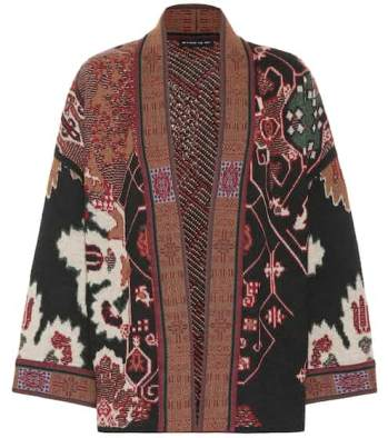 https://www.farfetch.com/uk/shopping/women/etro-embroidered-draped-cardigan-item-14262442.aspx?storeid=9838
