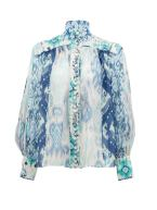 https://www.matchesfashion.com/products/Zimmermann-Glassy-Ikat-print-linen-blend-organza-blouse-1343182